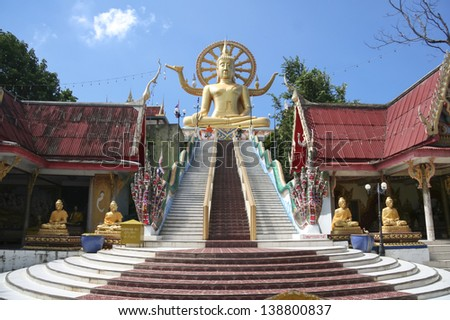 KOH SAMUI, THAILAND - DEC 4: Tourists at Wat Phra Yai  on December 4, 2008 in Koh Samui. The 12-metre high seated Buddha statue built in 1972 is one of the islands most popular attractions.