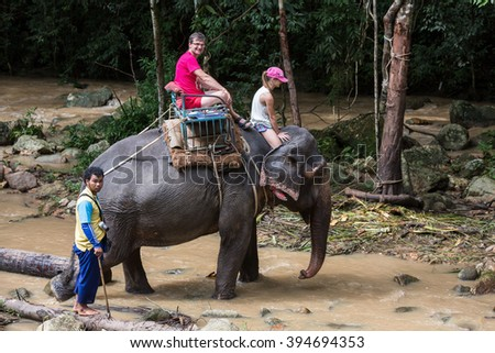 Koh Samui, Thailand â?? December 1, 2015: Tourists enjoying an elephant ride.