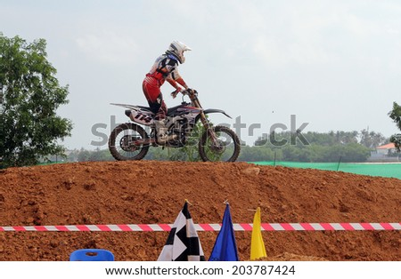 KOH SAMUI, THAILAND- DECEMBER 8. Unknown rider participates at Samui Motocross Championship, December 8, 2013 in Koh Samui Thailand - stock photo
