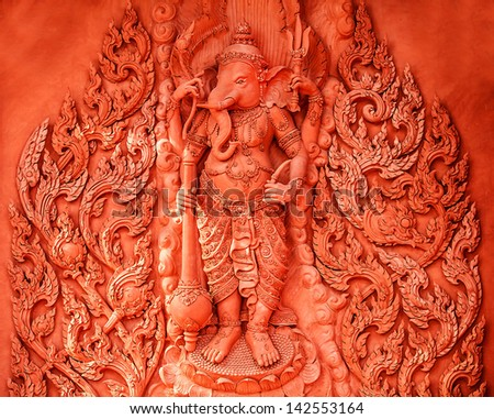 KOH SAMUI, THAILAND - FEB 25: Traditional stone sculpture of guardian. Historic temple, February 25, 2013 in Koh Samui, Thailand. More than 20 million people visit the country every year.