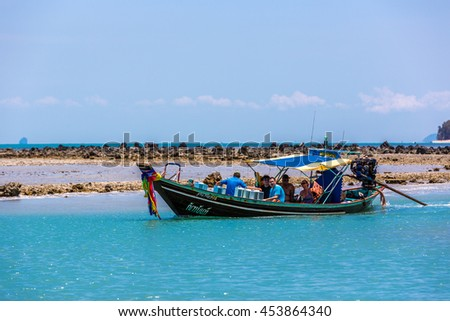 Koh Samui, Thailand - June 12th 2016 - Traditional boat with tourist in a blue water beach in Koh Samui island in Thailand, Asia