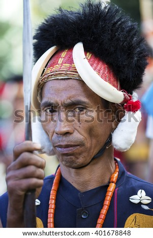 KOHIMA, NAGALAND/INDIA - DECEMBER 3, 2013: A portrait of a tribesman of Nagaland at the annual Hornbill festival.  The Hornbill is also known as the Festival of Festivals'.
