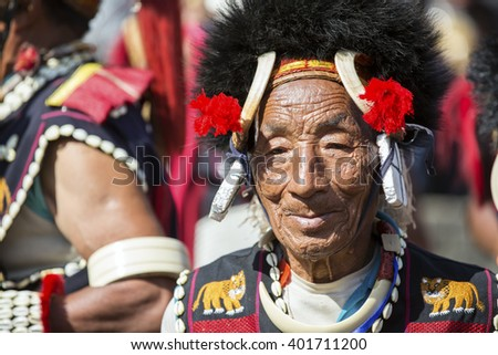 KOHIMA, NAGALAND/INDIA - DECEMBER 3, 2013: Tribesman of Nagaland at the annual Hornbill festival. The Hornbill is also known as the Festival of Festivals'. - stock photo