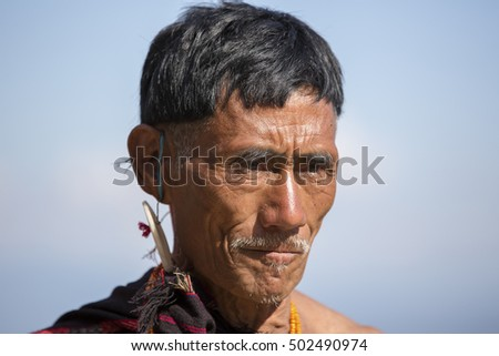 KOHIMA, NAGALAND/INDIA - DECEMBER 5, 2013: Tribesman of Nagaland at the annual Hornbill festival. The Hornbill is also known as the Festival of Festivals'.