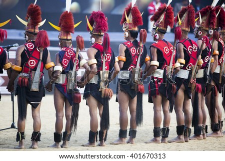 KOHIMA, NAGALAND/INDIA - DECEMBER 3, 2013: Tribesmen of Nagaland perform their traditional tribal dance at the annual Hornbill festival. The Hornbill is also known as the Festival of Festivals'.