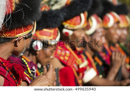 KOHIMA, NAGALAND/INDIA - DECEMBER 4, 2013: Tribesmen of Nagaland perform their traditional tribal dance at the annual Hornbill festival. The Hornbill is also known as the Festival of Festivals'.