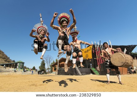 KOHIMA, NAGALAND/INDIA - DECEMBER 10  : Zeliang Naga tribesmen of Nagaland, India performing their traditional dance during  annual Hornbill Festival. - stock photo