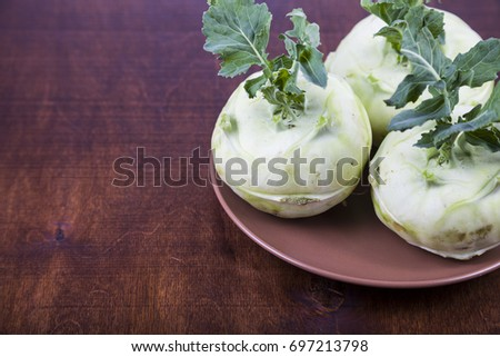Kohlrabi on a wooden table. Delicious cabbage close-up, healthy eating.