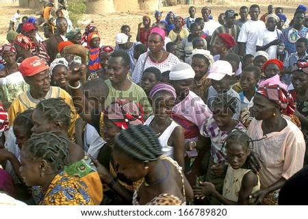 KOKEMNOURE, BURKINA FASO - FEBRUARY 24: Establishment of the new chief of village of Kokemnoure. The villagers expect the beginning of the ceremony, february 24, 2007 - stock photo