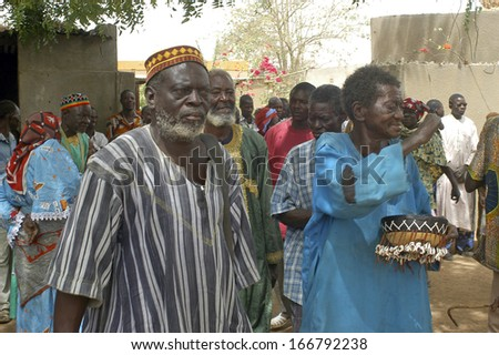 KOKEMNOURE, BURKINA FASO - FEBRUARY 24: Establishment of the new chief of village of Kokemnoure. The villagers expect the chief in front of his house, february 24, 2007