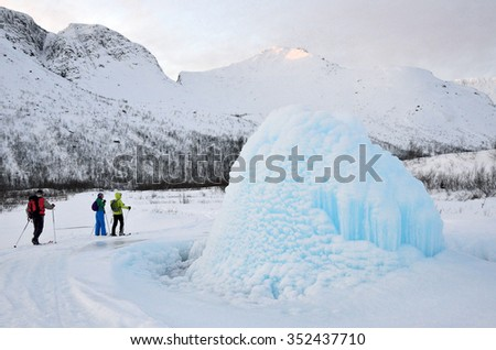 Kola Peninsula, Russia, December, 14, 2015. Skiers on the route in Khibiny in the polar day near  the cause of the icy hole with the emission of water between the lakes Big and Small Woodyavr