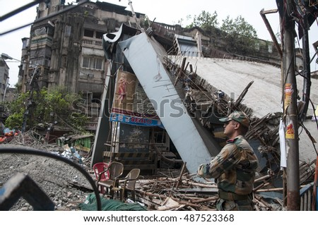 KOLKATA - APRIL 1: An Indian army personnel standing among the carnage during the rescue effort after an under construction flyover collapsed killing 27 people on April 1, 2016 in Kolkata, India.