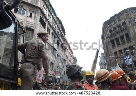 KOLKATA - APRIL 1: Police and rescue workers overseeing during the rescue effort after an under construction flyover collapsed killing 27 people on April 1, 2016 in Kolkata, India.
