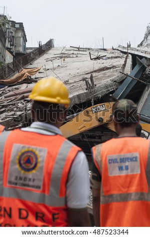 KOLKATA - APRIL 1: Rescue workers standing while the bridge in background during the rescue effort after an under construction flyover collapsed killing 27 people on April 1, 2016 in Kolkata, India.