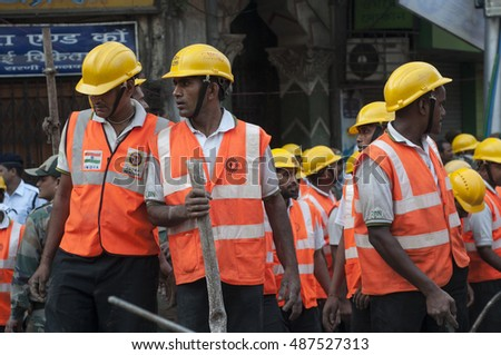KOLKATA - APRIL 1: Rescuers with gas cutters and axes  during the rescue effort after an under construction flyover collapsed killing 27 people on April 1, 2016 in Kolkata, India.