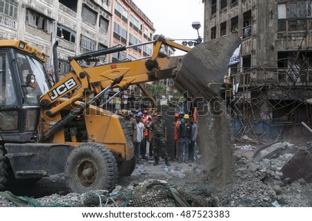 KOLKATA - APRIL 1: Truck cleaning up debris during the rescue effort after an under construction flyover collapsed killing 27 people on April 1, 2016 in Kolkata, India.