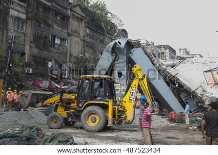 KOLKATA - APRIL 1: Trucks cleaning up to look for more dead bodies during the rescue effort after an under construction flyover collapsed killing 27 people on April 1, 2016 in Kolkata, India.