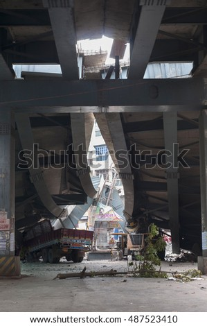 KOLKATA - APRIL 1: Twisted beams of the main frame  during the rescue effort after an under construction flyover collapsed killing 27 people on April 1, 2016 in Kolkata, India.