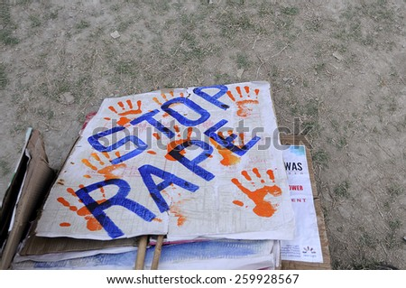 "KOLKATA - DECEMBER 16 : A ""stop rape"" sign lying on the floor after a rally to remember the gang raped victim from New Delhi in the year 2012 - on December 16, 2014 in Kolkata , India."