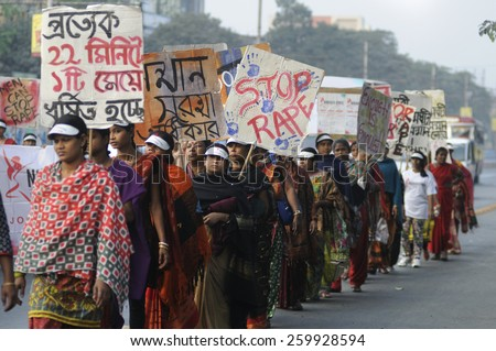 KOLKATA - DECEMBER 16 : Indian women with signs and banners during a rally to remember the gang raped victim from New Delhi in the year 2012 - on December 16, 2014 in Kolkata , India. - stock photo