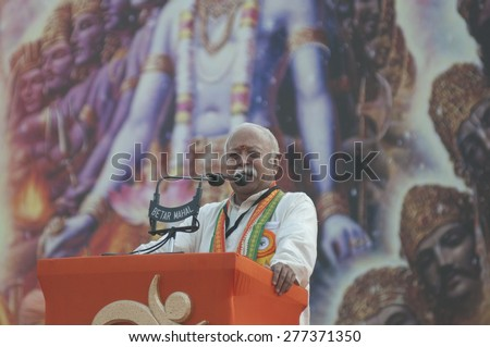 KOLKATA - DECEMBER 20: Mohan Bhagwat- the chief of Rashtriya Swayamsevak Sangh (RSS) giving speech during the Golden Jubilee celebration of VHP- on December 20, 2014 in Kolkata, India. - stock photo