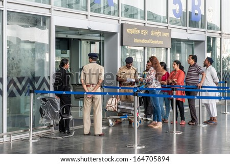 KOLKATA,INDIA - APRIL 19:The security police check ticket of passenger ...