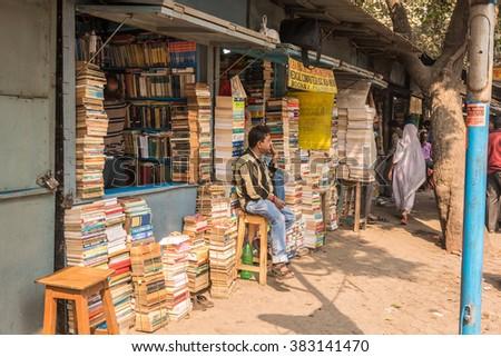 KOLKATA, INDIA - FEBRUARY 6: A street bookseller waits for customers at College Street Book Market on February 6, 2016 in Kolkata, West Bengal, India. - stock photo