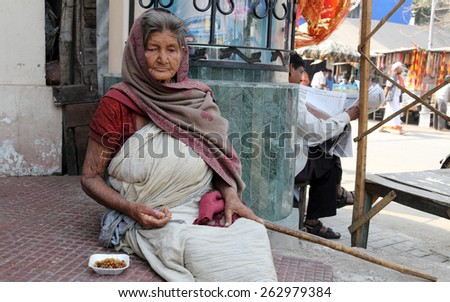 KOLKATA, INDIA - FEBRUARY 10, 2014: Beggars in front of Nirmal, Hriday, Home for the Sick and Dying Destitutes, established by the Mother Teresa and run by the Missionaries of Charity - stock photo