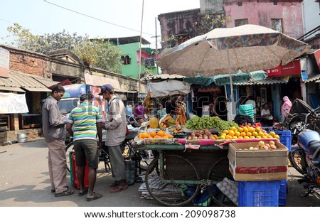 KOLKATA, INDIA - FEBRUARY 10: Street trader sell fruits outdoor on February 10, 2014 in Kolkata India. Only 0.81% of the Kolkata's workforce employed in the primary sector (agriculture) - stock photo