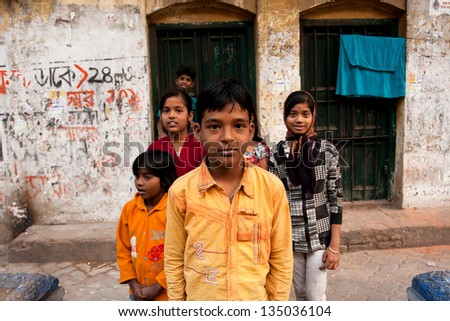 KOLKATA, INDIA - JAN 17: Unidentified children pose outdoor after school classes on January 17, 2012 in Kolkata, India. Kolkata's literacy rate of 87.14% exceeds the all-India average of 74%. - stock photo
