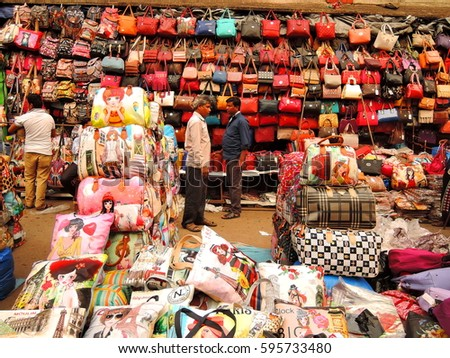Kolkata, India - March 04, 2017: A man selling ladies handbags in the market.