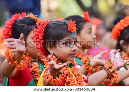 KOLKATA , INDIA - MARCH 5, 2015 : Girl child dancers performing at Holi / Spring festival, known as Dol (in Bengali) or Holi (in Hindi) celebrating arrival of Spring in India. A popular festival. - stock photo
