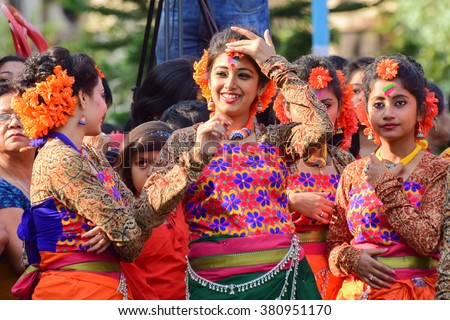 KOLKATA , INDIA - MARCH 5, 2015 : Young girl dancer's joyful expression at Holi / Spring festival, known as Dol(in Bengali) or Holi(in Hindi) celebrating arrival of Spring in India.A popular festival. - stock photo