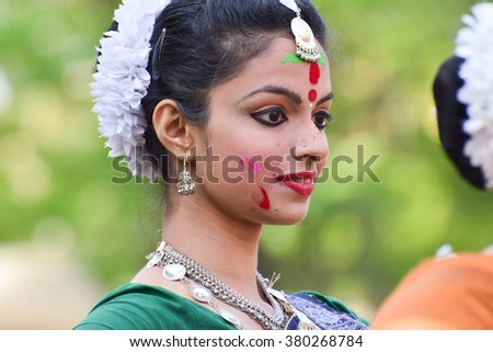 KOLKATA , INDIA - MARCH 5, 2015 : Young girl dancers performing at Holi / Spring festival, known as Dol (in Bengali) or Holi (in Hindi) celebrating arrival of Spring in India.  Big popular festival. - stock photo