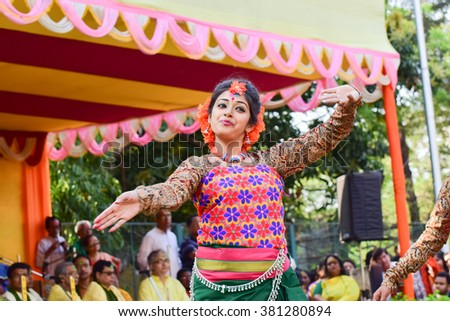 KOLKATA , INDIA - MARCH 5, 2015 : Young girl dancers performing at Holi / Spring festival, known as Dol (in Bengali) or Holi (in Hindi) celebrating arrival of Spring in India. A very popular festival. - stock photo