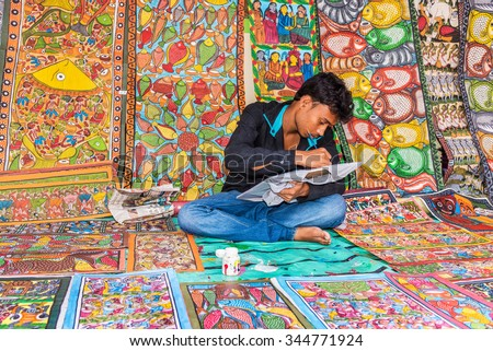 KOLKATA, INDIA - NOVEMBER 28: An Indian artisan paints on colorful handicraft items for sale during the annual State Handicrafts Expo 2015 on November 28 2015 in Kolkata West Bengal India.