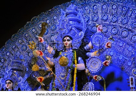 Kolkata, India - 10 October 2013:  An idol of revered goddess Durga standing in an unidentified pandal in the city of Kolkata during Durga Puja festival. A pandal is a temporary temple, erected during - stock photo