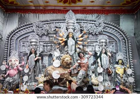 KOLKATA , INDIA - OCTOBER 2, 2014 : Durga idol at Puja festival. Biggest religious festival of Hinduism and local Bengali community, documentary editorial. - stock photo