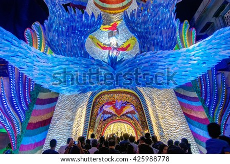KOLKATA , INDIA - OCTOBER 18, 2015 : Night image of decorated Durga Puja pandal, shot at colored light, at Kolkata, West Bengal, India. Durga Puja is biggest religious festival of Hinduism. - stock photo