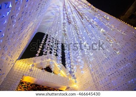 KOLKATA , INDIA - OCTOBER 18, 2015 : Night image of decorated Durga Puja pandal, shot at colored light, at Kolkata, West Bengal, India. Durga Puja is biggest religious festival of Hinduism.