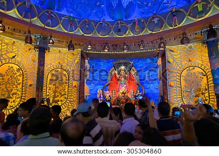 KOLKATA , INDIA - OCTOBER 3, 2014 : People enjoying inside Durga Puja Pandal (decorated temporary temple). Biggest religious festival of Hinduism and local Bengali community, documentary editorial. - stock photo