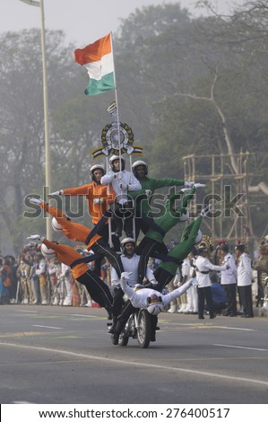 KOLKATA - JANUARY 19 :  Indian army soldiers performing motorbike stunts while carrying the Indian National flag during the Republic Day Parade preparation on January 19, 2015 in Kolkata, India.