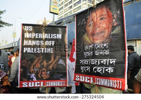 KOLKATA - JANUARY 24:Protesters with signs demanding USA to back off from Palestine to protest Obama's three day visit India to attend India�s Republic Day parade on January 24, 2015 in Kolkata,India. - stock photo