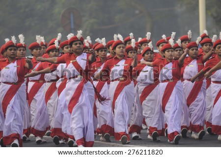 KOLKATA-JANUARY 19 :Women members of the Civil Defence department of West Bengal  marching in their red and white sari during the Republic Day Parade preparation on January 19, 2015 in Kolkata, India. - stock photo