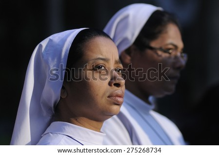 KOLKATA - MARCH 16 : Two Christian Nun with mournful looks during a candle light vigil to protest gang rape of an elderly nun on March 16, 2015, at Allen Park in Kolkata, India.  - stock photo