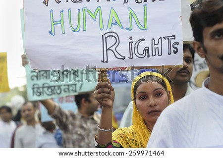 KOLKATA - NOVEMBER 15 :A Muslim girl holding pro men signs during a rally to celebrate the International Men's Day on November 15, 2014 in Kolkata, India. - stock photo