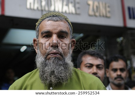 KOLKATA - NOVEMBER 15 : A Muslim man standing on the side walk  during a rally to celebrate the International Men's Day on November 15, 2014 in Kolkata, India. - stock photo
