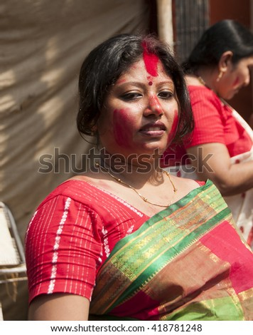 KOLKATA - OCT 17 : Married Bengali Hindu women smear and play with vermilion during Sindur Khela traditional ceremony on the final day of Durga Puja festival on October 17, 2010 in Kolkata, India. - stock photo