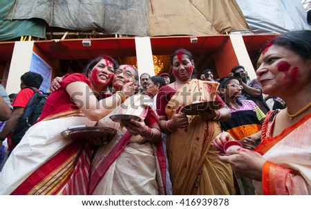 KOLKATA - OCT 17 : Unidentified Hindu women play with vermilion during Sindur Khela traditional ceremony on the final day of Durga Puja festival on October 17, 2010 in Kolkata, India. - stock photo