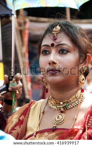 KOLKATA - OCT 17 : Unidentified Hindu women play with vermilion during Sindur Khela traditional ceremony on the final day of Durga Puja festival on October 17, 2010 in Kolkata, India.